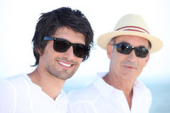 Son and father in summer. Man with his father in the sunshine royalty free stock images
