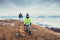 Son and father walk with dog on hill with top view panorame on c. Ity stock photography