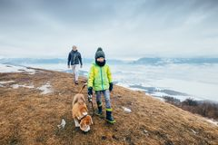 Son and father walk with dog on hill with top view panorame on c. Ity stock photos