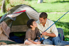 Son fishing with his father. Joyful son fishing with his father Stock Photos