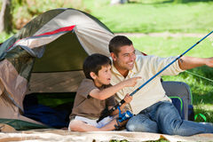 Son fishing with his father. Happy son fishing with his father Royalty Free Stock Photos