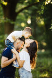 Son give a lovely kiss for mother outside. Background royalty free stock photography