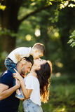 Son give a lovely kiss for mother  outside. Background Royalty Free Stock Photo