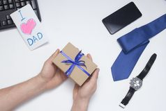 Son gives a gift to dad. Father`s Day. royalty free stock image