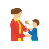 Son gives to mother flowers. Mother's Day. Stock Image
