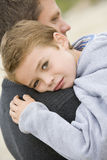 Son giving Father cuddle. On the beach royalty free stock photo