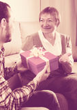 Son giving present to mother Stock Photo