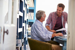 Son Giving Senior Parent Financial Advice In Home Office Stock Images