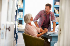 Son Giving Senior Parent Financial Advice In Home Office Royalty Free Stock Photos