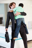 Son Greets Father On Return From Work. Smiling royalty free stock photography