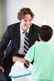 Son Greets Father On Return From Work. Smiling royalty free stock photos
