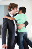 Son Greets Father On Return From Work. Smiling stock images