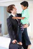Son Greets Father On Return From Work. Smiling royalty free stock photo
