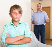 Son having domestic quarrel with father Stock Image