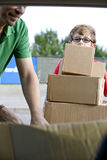 A son helping his father recycle cardboard boxes Stock Images