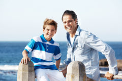 Son with his father on beach Royalty Free Stock Photo