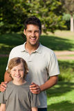 Son and his father outside. Son and his father in the park Stock Photography