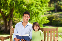 Son with his father reading a book Royalty Free Stock Photo