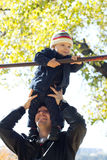 Son on his father's shoulders having fun. Little son on his father's shoulders having fun Royalty Free Stock Photos