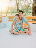 Son with his father on a wooden couch Royalty Free Stock Images