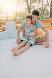 Son with his father on a wooden couch Stock Photos