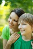 Son with his mom. At the nature royalty free stock photo