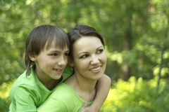 Son with his mom. On the nature Stock Image