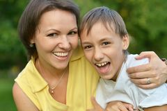 Son with his mom. On the nature royalty free stock photo