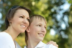 Son with his mom. On the nature stock photography