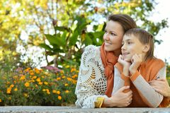 Son with mom. Son with his mom sitting at table outdoors Stock Photography