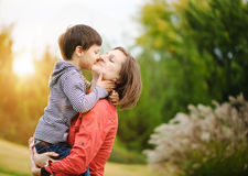 Son with his mother. Son is kissing his mother Royalty Free Stock Image