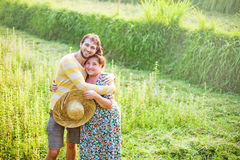 Son with his mother at the field. Son with his mother hugging at the field Stock Photography