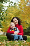 Son with his mother in the park. Son with his mother in a park in autumn Stock Photos