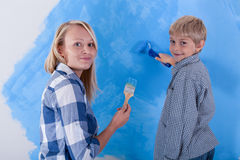 Son and his young mother painting the new apartment Royalty Free Stock Photography