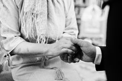 Son hold mother hand at blessings. Groom at church.  Stock Image