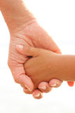 Son holding hand of his mother Stock Images