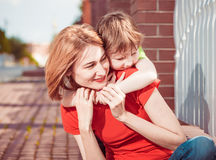 Son holding mother Royalty Free Stock Photography