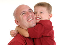 Son Hugging Dad Around the Neck Stock Photo