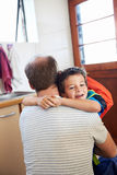 Son hugging dad. Father and son hug goodbye before school love and affectionate embrace Royalty Free Stock Photography