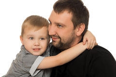 Son hugging dad. Happy son hugging his neck the arms of his beloved father. Close-up - Isolated on white background Stock Photos