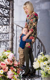 Son hugging her mother. On the spiral staircase Royalty Free Stock Photography