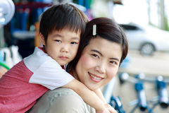 Son is hugging his mother Stock Image