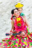 Son hugging his mother in Mexican costume and Stock Photography