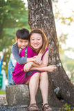 Son hugging mother Asian family. In the park Royalty Free Stock Photography