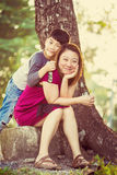Son hugging mother Asian family. In the park Royalty Free Stock Images