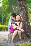 Son hugging mother Asian family. In the park Royalty Free Stock Photos