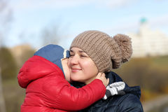 Son hugging mother. Son hugging his mother ath the park in autumn Stock Photography