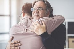 Son hugs his own father stock images