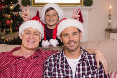 Son joking to his father and grandfather. At home in the living room Stock Image