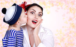 Son kissed his mother. Son tender kissed his mother. Abstract background with hearts stock image